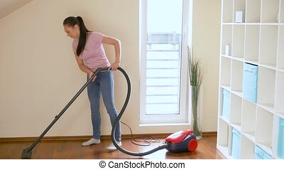 woman or housewife with vacuum cleaner at home - household,...