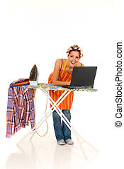 Household, ironing, internet - Young attractive housewife...