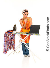 Household, ironing, internet - Young attractive housewife ...