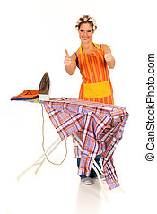 Young attractive housewife with curlers in hair doing household, ironing, Studio, white background.