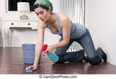 A housekeeper on her knees