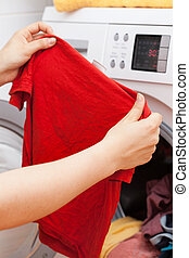 Housekeeper doing the laundry