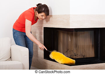 Horizontal view of a housekeeper during dusting