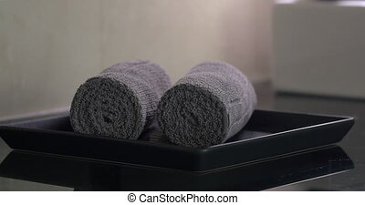 Housekeeper placing clean towels in hotel room - Close-up...