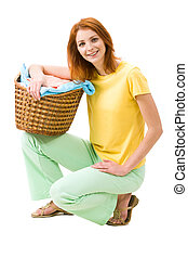Portrait of young female with stack of colorful towels smiling to camera