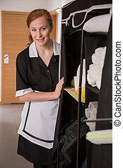 Housekeeper segregating sanitary article - Housekeeper in...