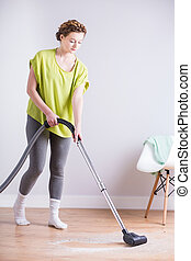 Housekeeper with vacuum cleaner