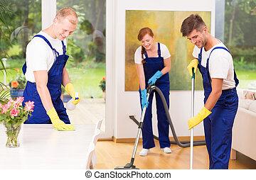 Housekeepers cleaning floor