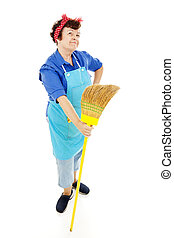 Retro looking housekeeper looks into the distance and imagines a better life. Isolated on white.