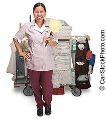 Housekeeping - Female hotel maid with housekeeping cart...