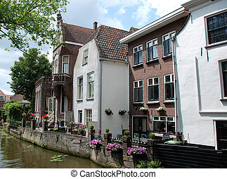 Houses along a canal. - Houses along a canal in Delft, The...