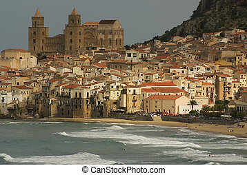 Houses along the shoreline and cathedral in background,...