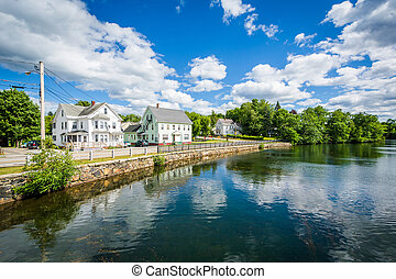 Houses along the Winnipesaukee River, in Laconia, New ...