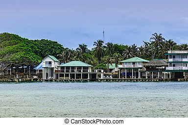 Houses and bungalows on the shores of the blue waters of ...