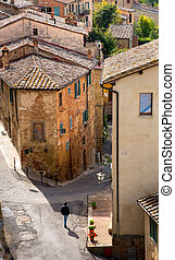 Houses and empty street at Montepulciano medieval italian hill town in Tuscany Italy, Europe