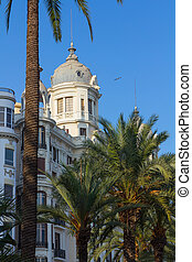 Houses and palm trees of the city of Alicante, Spain