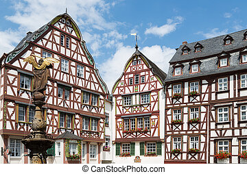 Houses and statue in medieval Bernkastel, Germany - Medieval...