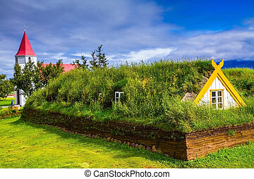 Houses are roofed by the turf and grass. Village of...