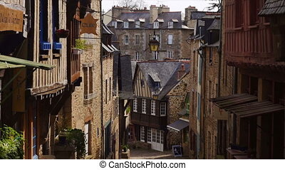 houses at the street of Dinan - DINAN, FRANCE - APRIL 06,...