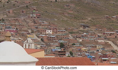 Houses built close to each other at the foot of a hill