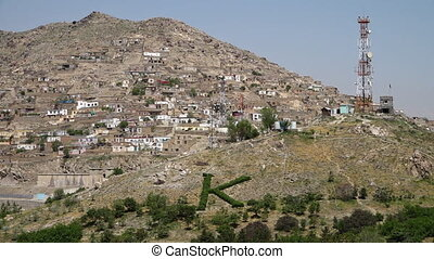 Houses built on a hill - A steady, long shot of a...