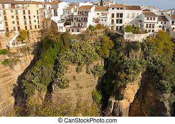 Houses built on Ronda canyon. Ronda is a beautiful city in the most Northwest side of the province of Malaga, Spain.