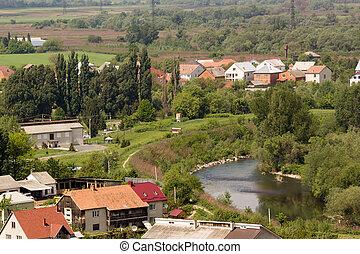 Houses by the river Latorytsa in Mukachevo