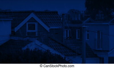 Houses In Rainfall At Night - Typical town scene of houses...