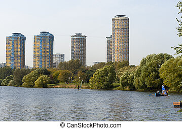Houses in Strogino on the background of the river, Moscow.
