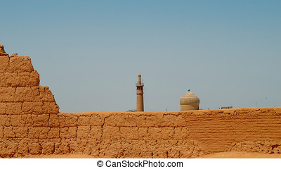 Houses of abandoned mud brick village of Kharanaq in Iran.