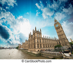 Houses of Parliament and River Thames, London. Beautiful wide angle view at sunset.