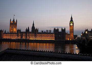 Houses of Parliament in Westminster Illuminated at Night in London, England, UK
