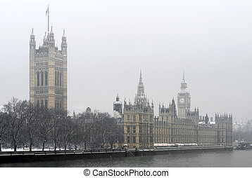 Houses of Parliament Building and Big Ben, Westminster, London, England, on a cold, snowy, Winter's day.