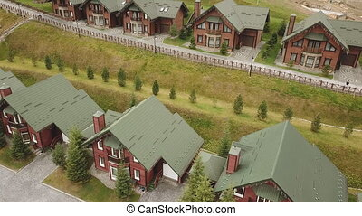 the same type of house with a green roof, aerial view