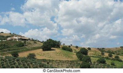 Houses on a hill slope. - Houses on a hill slope in a sunny...