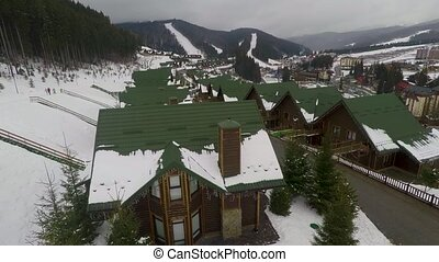 houses on hill in winter. Bukovel ski resort, Carpathian,...