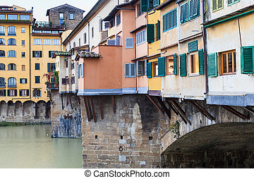 houses on ponte vecchio in Florence city in autumn