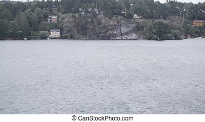 Houses on shores of Finland - View from ferry to islands and...