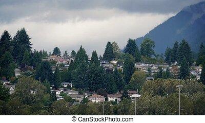 Houses On Slope Near Misty Mountain