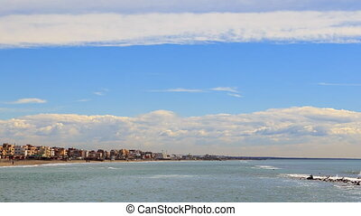 Houses on the beach in Ostia, Rome, Italy. Time Lapse