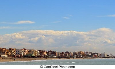 Houses on the coast. Ostia, Rome, Italy. Time Lapse