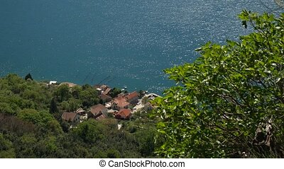 Houses on the coast. View from the mountain to the house on the
