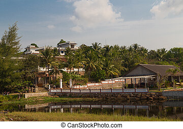 houses on the shore of a tropical lake