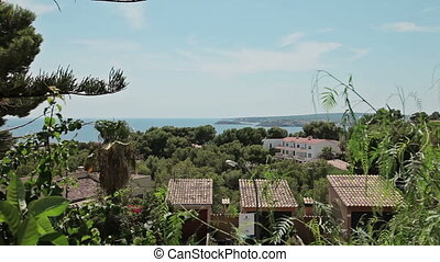 Houses on the slopes of hills, villas and mansions. Spanish beaches in Costa d'en Blanes. Mallorca