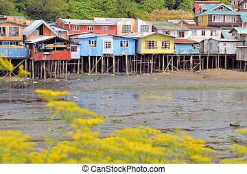 Houses raised on pillars over the water in Castro, Chiloe