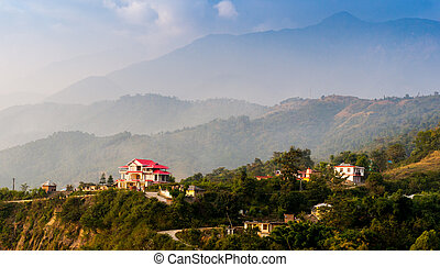 houses surrounded by hills in Himachal India