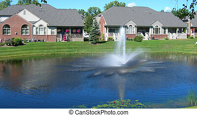 Houses surrounding pond - Neighborhood houses with a ...