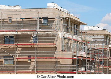 New Family Houses under Construction - With Scaffolding