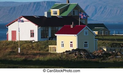 Houses with Icelandic flags on the Atlantic coast. Andreev....