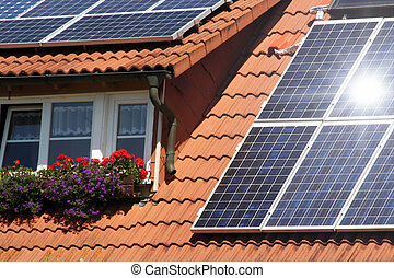 Housetop with solar an flowers on the window